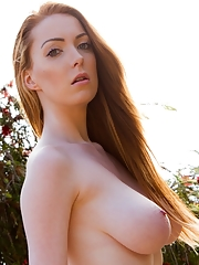 Alice Brookes is a stunning busty redhead