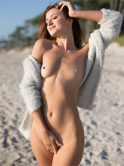 Elina Love exposes her flawless figure on a sunny beach