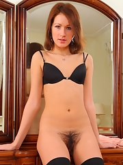 Hairy petite amateur Margot spreading muff in lingerie