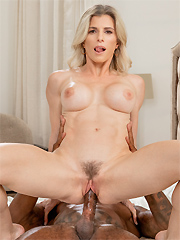 Cory Chase bangs a black stud behind her husband's back