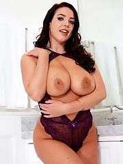Angela White hiding her big natural tits under lingerie bodysuit