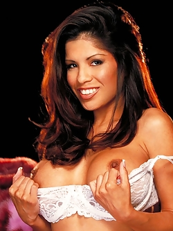 Alexis Amore gets naughty between her white stockings