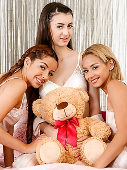 It's Saturday night and teens Vanna Bardot, Veronica Leal and Lina Luxa are ready for a little slumber party fun! Vanna has a really naughty idea for what might spice up their slumber party snoozefest, so she breaks out a suitcase filled with the biggest dildos they've ever seen. Licking their lips, the girls take turns sucking on a rainbow-colored cock to see who can deep-throat it the furthest. It's a three-way tie as Vanna, Lina, and Veronica tickle their tonsils with it, each shoving it down their eager throats. Veronica ups the ante and pulls out a massive pink dildo bigger than her arm. Their eyes widen in shock. There's no WAY that thing is going to fit in their mouths...although it might fit in their OTHER holes! But before they can work up the courage to stuff themselves with that monster cock, the girls want to warm up by checking out each other's boobs. They strip off their shirts and get a look at each other's luscious young titties. Their pussies dripping from the eye-full they're getting, they go in for a handful too, squeezing and playing with the perfect pairs on display. Now that they're done comparing boobs, these troublemaking teens are ready to dive into each other's REALLY naughty bits!