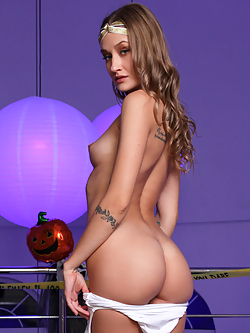 We've brought back super popular hottie Tiffany Tatum for a Halloween adventure. Watch this lovely blonde stunner slip out of her costume and take the time to explore herself from breasts to bottom with her talented fingers. That's not enough to make her cum, but her vibrating toy certainly does the trick!