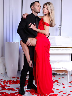 This month's fantasy of the month, Gina Gerson, has taken the time to describe her perfect scene. This sensual sweetheart wants flowers, elegance, and a touch of class. She gets it, with a long sweeping dress, a bed of rose petals to rub all over her skin, and Raul Costa in a tux to run a rose along her skin.