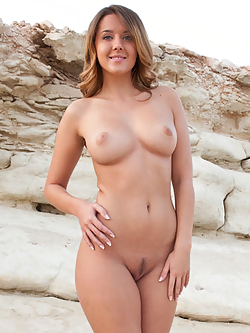 Busty babe spreads her ass in a quarry