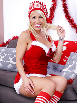 Looking fine and fuckable, Tiffany Rousso is the Christmas milf of your fantasies. This blonde and busty elf will happily slip out of her costume and then her bra and thong. Watch as she squeezes that ass and then slams two fingers deep into her cock hungry fuck hole until she's cumming hard.