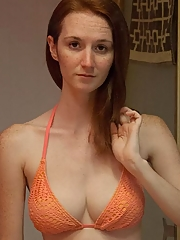 Super busty and fit redhead in a bikini