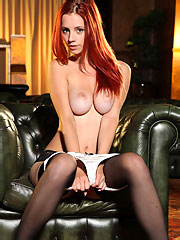 redhead babe in silky lingerie and black stockings