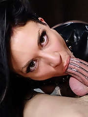 Mistress Andy San Dimas plays with her slave's chastised cock as he worships her pussy