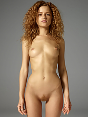 Petite redhead Julia poses nude to share her athletic body