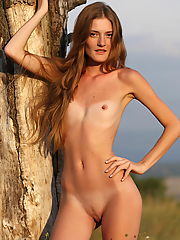 Skinny Claudia stripteases in nature to show her tanlines and perky tits