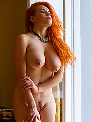 Busty naked redhead in natural light
